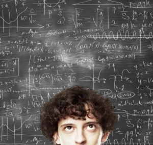thinking man against desk with formulas