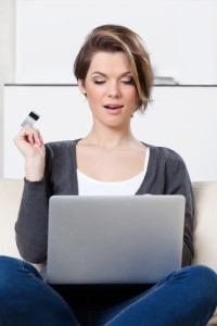 Beautiful woman makes bargains through the internet and wonders its low prices