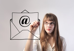 Businesswoman drawing an envelope with an e-mail sign